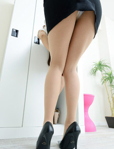 Sexy dressing asian in pantyhose and sexy fashion skirt