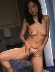 Hairy pussy asian chick with erected nipples