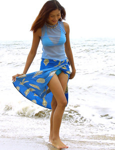 Asian chick in blue bikini nude on the beach